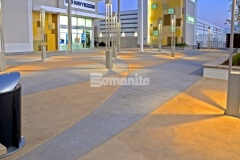 Inspired by the racetrack infield at the nearby Daytona International Speedway, this beautiful decorative concrete paving features an interior checkerboard pattern that was created using Bomanite Integral Color with two-tone coloration that will provide longevity and durability of color.