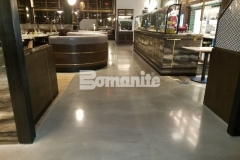 This Bomanite Modena custom polished concrete flooring was ground and polished to a medium satin finish and given two coats of Bomanite Stainguard to create a final seal and durable protection, while adding a distinctive feature throughout this restaurant.