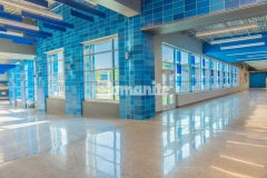The Bomanite Modena SL Custom Polishing System was utilized at Grain Valley High School as a low-cost alternative to renovate the hallways, providing durability and strength, while featuring a beautiful refined cream polished surface that highlights the salt and pepper aggregate finish.