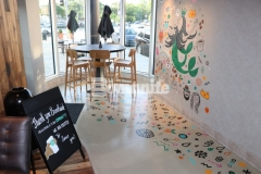 Bomanite Modena SL was expertly installed by our colleague, Musselman & Hall Contractors, to create a polished, highly durable cementitious overlay that was selected by Starbucks as a low-cost concrete flooring alternative that will provide durability and strength while adding a simple, elegant finish that serves as the perfect backdrop for this playful and colorful mural.