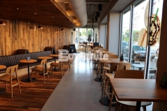 Integrally colored Bomanite Modena SL was utilized here to create a ground and polished decorative concrete overlay that will provide a highly durable finish and add a simple yet sophisticated design aesthetic inside this Starbucks coffeehouse.