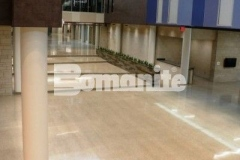 The Bomanite Renaissance Deep Grind System was installed at Olathe West High School to create a two-inch thick unbonded concrete topping slab that showcases local aggregates and was polished to create a semi-gloss concrete finish.