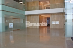 The stunning decorative concrete lobby flooring inside the Cypress Waters Business Complex was created using the Bomanite VitraFlor Custom Polishing System, with a 1,500-grit polish and salt and pepper finish that add warmth and a high-end, sophisticated feel.