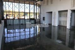Premier Concrete Construction used the Bomanite VitraFlor custom polishing system to create a lustrous, mirror like finish that is so stunning that you can actually see your reflection on the surface of the decorative concrete flooring in the Border Patrol Station in Derby Line, Vermont.