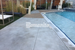 Earning the Bronze Award in 2017 for Best Bomanite Exposed Aggregate Project, our associate Bomanite of Tulsa, Inc., expertly installed this Bomanite Alloy pool decking, creating a stunning finished product that will provide durability, slip resistance, and add a glamorous decorative touch to the Hard Rock Hotel pool deck.