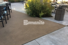 Bomanite Alloy decorative concrete was installed here to create a cohesive decking surface that is durable, adds slip resistance next to the pool, and amplifies the sleek, stylish design aesthetic at the Hard Rock Hotel & Casino.