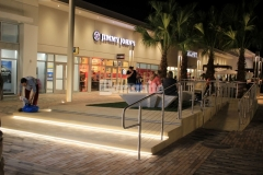 Bomanite Alloy with seashell exposed aggregate was installed here to create a decorative concrete step plaza and handicap ramp with a distinct and durable finish that emphasizes the beach-industrial aesthetic styling at the Tanger Outlets in Daytona Beach, FL.