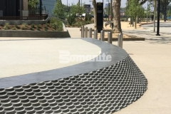 Our associate, Bomel Construction Company, installed Bomanite Alloy to create decorative bands of concrete at the LAFC Banc of California Stadium, incorporating clear glass aggregates and reflective mirror flakes to add intricate, eye-catching detail to the hardscape surface.