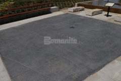 This hardscape features Bomanite Alloy Exposed Aggregate decorative concrete with custom engraved details that add distinctive beauty and a personalized touch to this outdoor gathering space.