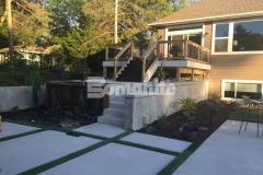 The Bomanite Antico process was used in this backyard to create wall caps to top these cast-in-place concrete retaining walls and the travertine-like finish complements the old-world charm in this backyard resort.