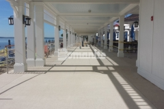 The Beach Area at the Westchester Country Club features Bomanite Revealed, which was chosen to provide a highly decorative surface that combines the durability of concrete with color and pronounced decorative aggregate, creating a unique element of design that harmonizes beautifully with the oceanside view.