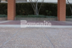 The Residence Condominiums ownership enlisted Musselman & Hall Contractors to install Bomanite Bomacron English Sidewalk Slate imprinted concrete with a Bomanite Sandscape Texture Exposed Aggregate finish to revamp the aging pavement at the front entrance and the finished product will not show wear from traffic or need constant resealing to look fresh and maintain functionality.