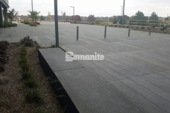 Sandscape Texture by Bomanite was paired with Bomanite Con-Color in gradient shades of gray to create a decorative concrete hardscape surface that has modern lines and adds a distinctively beautiful design feel to the space.