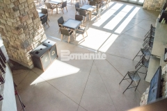 Colorado Hardscapes installed decorative concrete throughout the site of the Gaylord Rockies Resort & Convention Center that included both imprinted concrete as well as exposed aggregate decorative concrete and featured here is Bomanite Exposed Aggregate Sandscape Texture that was installed in this space to add cohesion with the interior flooring and exterior hardscapes across the resort.