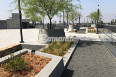 A gray Bomanite Exposed Aggregate Sandscape Texture finish was added to these lineal planters and circular tree planters to create textural interest that is a beautiful accent on this rooftop terrace and garden.