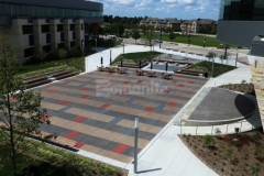 This stunning decorative concrete hardscape features Bomanite Sandscape Texture that was installed here with a custom stain pattern that is visually pleasing and creates visual continuity throughout the space.