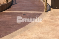 Bomanite imprinted concrete was installed here using the Bomacron Boardwalk pattern to create a decorative decking surface that resembles wood planking and adds beautiful design detail to this outdoor space.