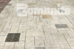 Bomanite Imprint Systems were utilized here to create a decorative concrete hardscape that features the Bomacron Ashlar Slate pattern with a border of integrally colored gray concrete for a combination that adds beautiful charm and distinctive design to this outdoor space.