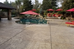 This expansive backyard pool deck and patio features the Bomacron Slate Texture imprint pattern that was installed with Bomanite Sand Color Hardener and Bomanite Light Brown Release Agent to enhance the natural aesthetic in this backyard oasis.