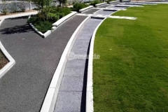 Owasso's Redbud Festival Park showcases Bomanite Bomacron Chipped Shale stamped concrete that was used to create a splash pad and water feature that emulate a riverbed of rock, with coloration and design that add unique detail to the hardscape.