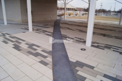 Redbud Festival Park in Owasso, Oklahoma features Bomanite Sandstone imprinted concrete accent borders that were installed to create definition against the concrete pavers in the pavilion area and are the perfect complement to the other design elements throughout the park.