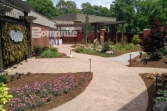 Bomanite imprinted concrete is featured here with multiple textures, colors, and patterns including the Bomacron Regular Slate and Bomacron Small Sandstone patterns and this stunning hardscape emphasizes the peaceful and tranquil design aesthetic in the healing garden at CMC Mercy Hospital.
