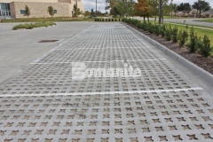Featured here is Bomanite Grasscrete that was installed using biodegradable Molded Pulp Formers and crushed stone to fill the voids in order to create an eco-friendly pervious concrete parking lot that will provide a decrease in the overall impervious percentage on the site while allowing for proper stormwater drainage.