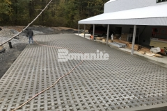 Grasscrete by Bomanite is a continuously reinforced, cast-in-place, pervious concrete solution that Premier Concrete Construction installed at this residence to reduce site runoff while accommodating large delivery vehicles.