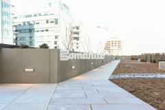 Micro-Top ST by Bomanite was applied here as a decorative concrete overlay on these planter walls and planter boxes, using a sand-finished texture to reflect the urban lifestyle design at this mixed-use luxury condominium development.