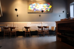 Micro-Top by Bomanite is a cementitious topping that tenaciously bonds to virtually any substrate, making it the ideal product choice to renovate multiple flooring surfaces inside the Elmwood neighborhood restaurant, which resulted in cohesive flooring that is a distinctive design element inside this space.
